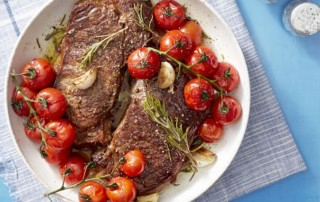 Seared Steak with Blistered Tomatoes on White Dish